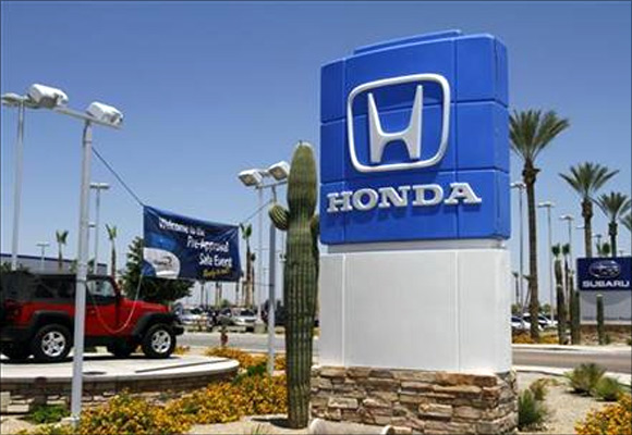 A Honda sign is displayed outside SanTan Honda Superstore in Chandler, Arizona.
