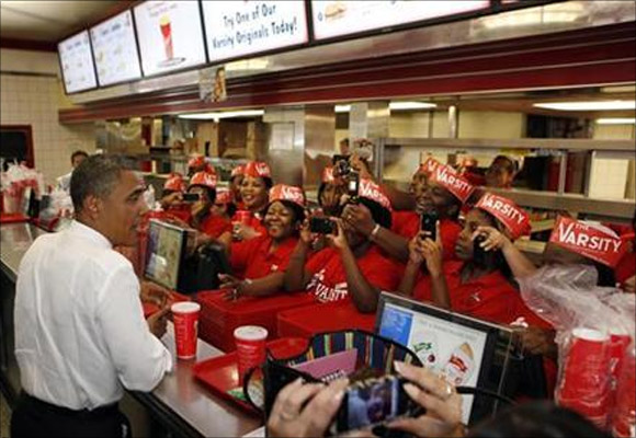 US President Barack Obama orders food inside the Varsity restaurant in Atlanta, Georgia.