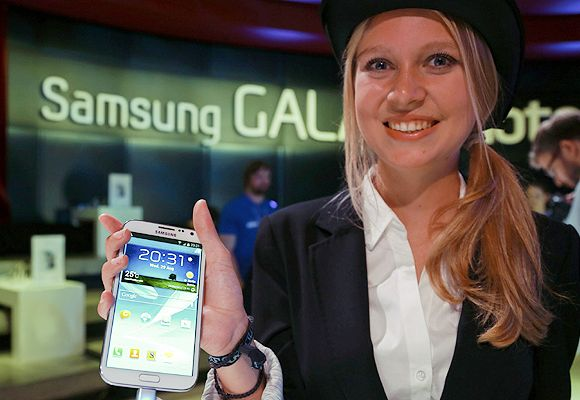 A model poses with the new Samsung Galaxy Note II tablet device during Samsung Mobile Unpacked 2012 event in Berlin.