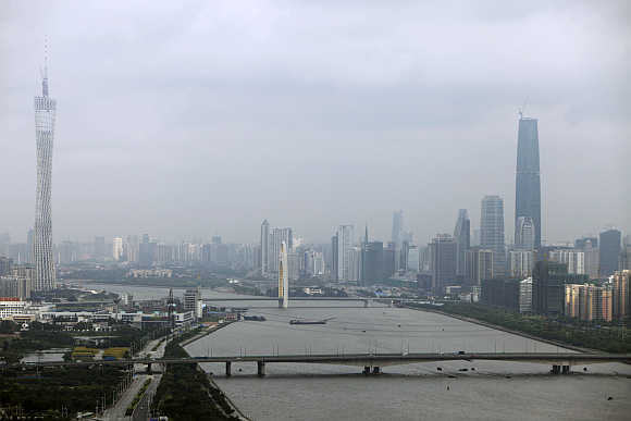 A view of 610-metre high Guangzhou TV & Sightseeing Tower, left, in Guangzhou.