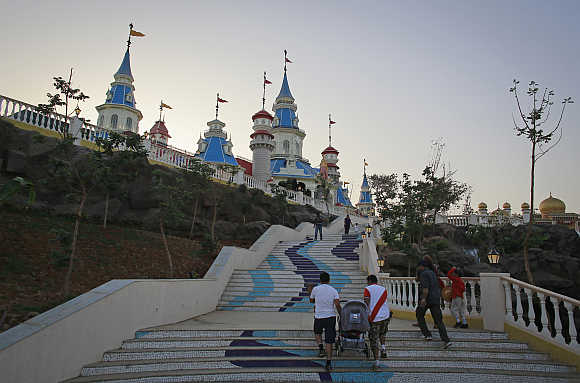 Visitors climb a flight of stairs in Adlabs Imagica theme park.