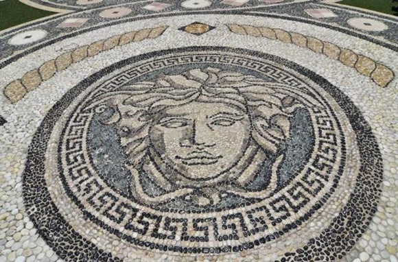 Mosaic on the the patio of the South Beach mansion.