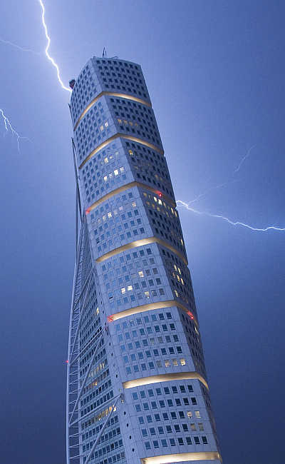 Lightning strikes the 190 metre (623 ft) high Turning Torso building in Malmo, Sweden.