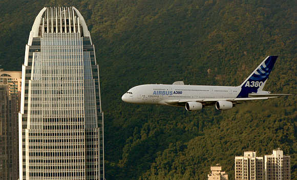 An Airbus A380 flies past International Finance Centre in Hong Kong.