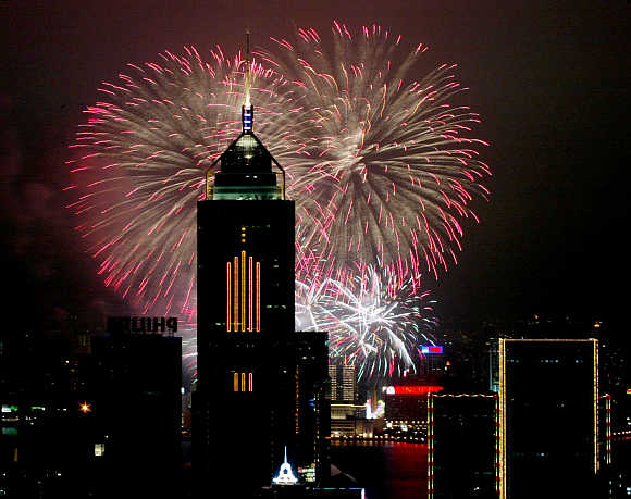 Fireworks explode in front of Central Plaza in Hong Kong.
