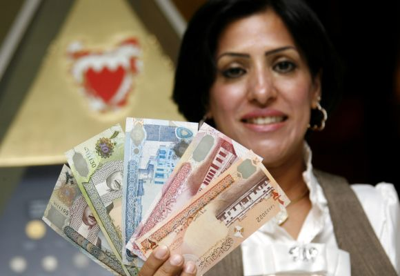 A Central Bank of Bahrain official shows new Bahraini Dinar notes on the first day of its release in Bahraini capital of Manama.