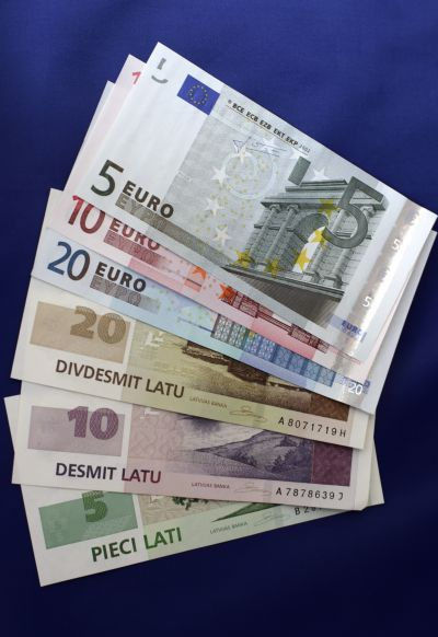 Latvia's lats and euro banknotes are seen in this illustration picture.