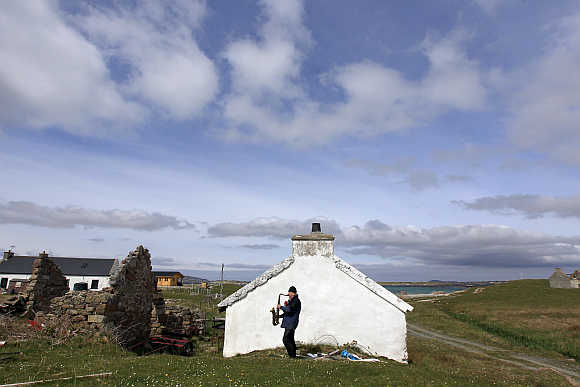 Artist and poet Barry Edgar Pilcher, 69, plays the saxaphone on the Island of Inishfree in County Donegal. Pilcher is the only inhabitant of the island on which he has lived for the past 20 years. He only leaves the island once a week to collect his pension and buy groceries on the mainland.