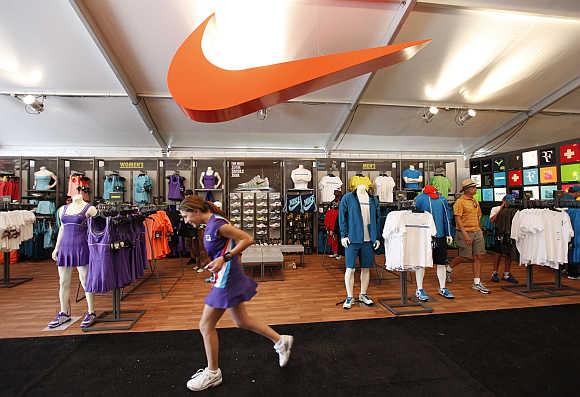 A ball girl runs past the Nike boutique at the Sony Ericsson Open tennis tournament in Key Biscayne, Florida. Nike is one of Global Experience Specialists's clients.