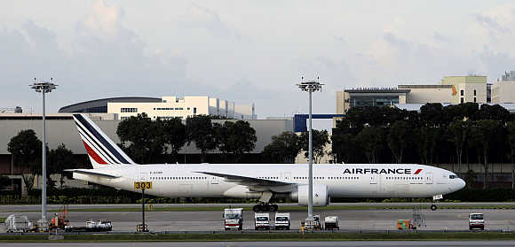 An Air France plane taxis on the runway of Singapore Changi Airport. Air France is one of Havas's clients.