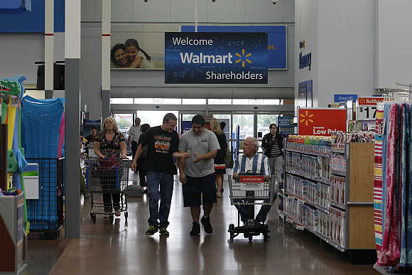 Customers shop at a Walmart Supercenter in Rogers, Arkansas. Walmart is one of Merkle's clients.