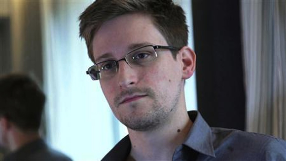 Former US spy agency contractor Edward Snowden is seen in this still image taken from video during an interview by The Guardian in his hotel room in Hong Kong.