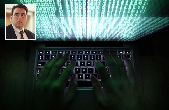 A man types on a computer keyboard in Warsaw in this February 28, 2013 illustration file picture. David Smith (inset)