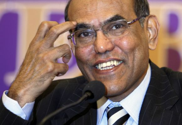 India's central bank governor Duvvuri Subbarao smiles during a news conference.