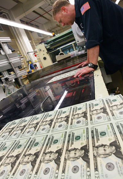 A press is printing twenty dollar US bills at the Bureau of Engraving and Printing in Washington, DC.
