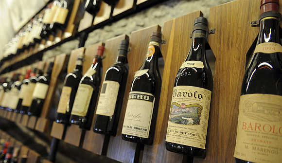 Bottles of Barolo wine are seen on a wall at the Barolo wine museum in Barolo, about 70km south of Turin, Italy.