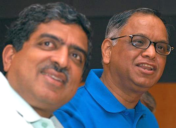 N. R. Narayana Murthy (R) and Nandan M. Nilekani attend a news conference in Bangalore, April 14, 2006.