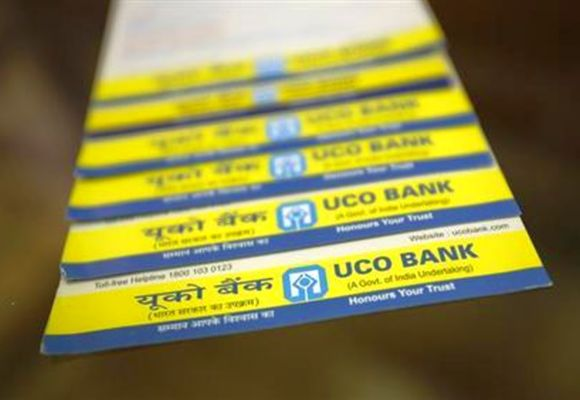 Leaflets advertising loans are pictured inside a commercial branch of the UCO Bank in Mumbai.