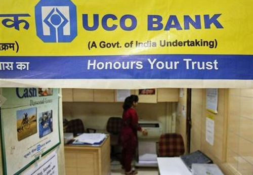 A staff member works inside a commercial branch of the UCO Bank in Mumbai.