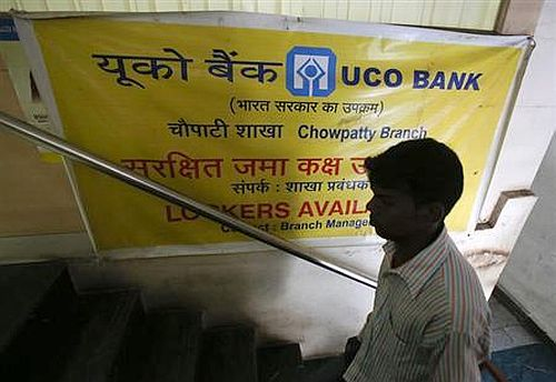 A customer enters a commercial branch of the UCO Bank in Mumbai.
