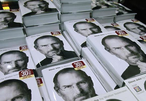 Copies of the new biography of Apple CEO Steve Jobs by Walter Isaacson are displayed at a bookstore.