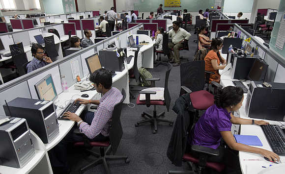 Workers at their workstations on the floor of an outsourcing centre in Bangalore.