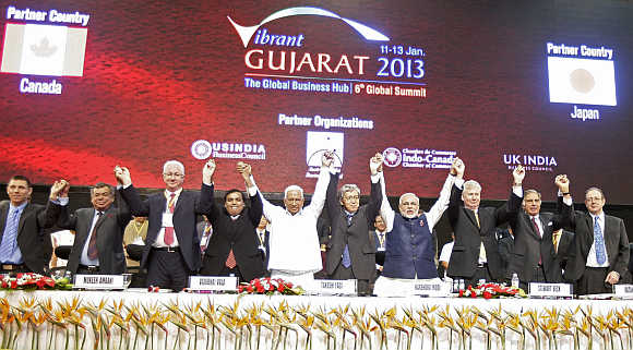 Essar Group Chairman Shashi Ruia, Chairperson of the Regional Government of Astrakhan Konstantin Markelov, Reliance Industries Chairman Mukesh Ambani, former Gujarat finance minister Vajubhai Vala, Japan's Ambassador to India Takeshi Yagi, Gujarat Chief Minister Narendra Modi, Canadian High Commissioner to India Stewart Beck, Tata Group Chairman Emeritus Ratan Tata and British High Commissioner to India James Bevan at the 'Vibrant Gujarat Summit' in Gandhinagar, Gujarat.