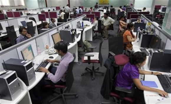 Workers are seen at their workstations on the floor of an outsourcing centre in Bangalore.