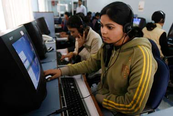 Employees at work at a call centre in Chandigarh.