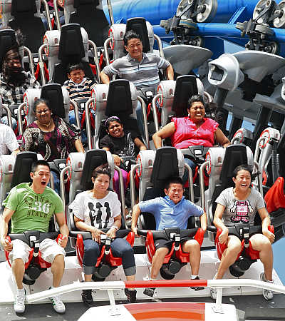 Visitors ride the 'Battlestar Galactica' duelling roller coaster at the Universal Studios theme park in Singapore.