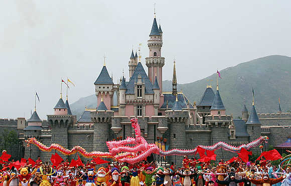 Disney characters perform in front of the Sleeping Beauty Castle in Hong Kong.