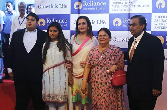 Mukesh Ambani (R), chairman of Reliance Industries Limited, poses with his son Akash, daughter Isha (2nd L), wife Nita (C) and mother Kokilaben, before addressing the annual shareholders meeting in Mumbai June 6, 2013.