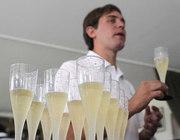 An expert holds a glass of sparkling wine at Casa Bianchi in San Rafael, Argentina.