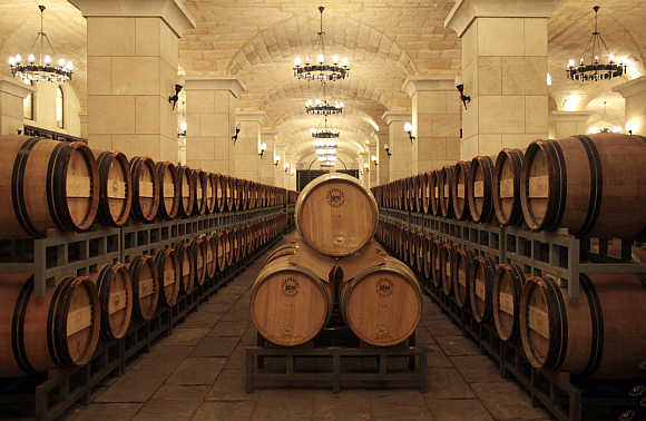 Barrels of wine are seen inside a cellar in Chateau Changyu Afip Global on the outskirts of Beijing.