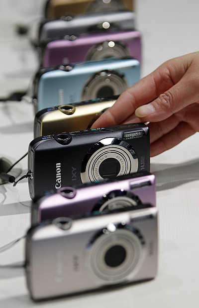 Cameras from Canon's compact IXY series are displayed at the company's showroom in Tokyo.
