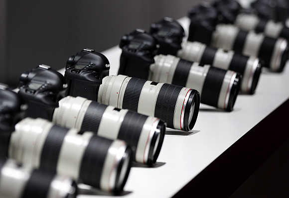 Canon cameras with lenses in Cologne, Germany.
