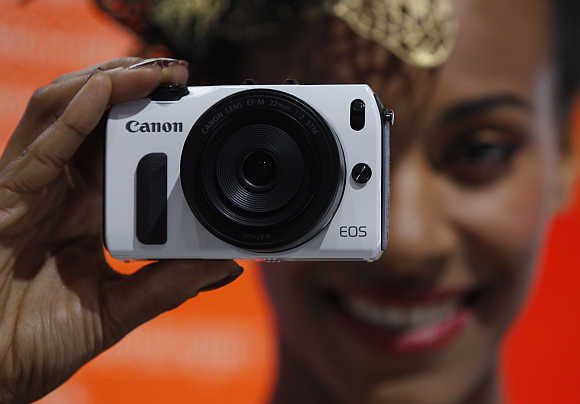 A model presents Canon S110 in Cologne, Germany.
