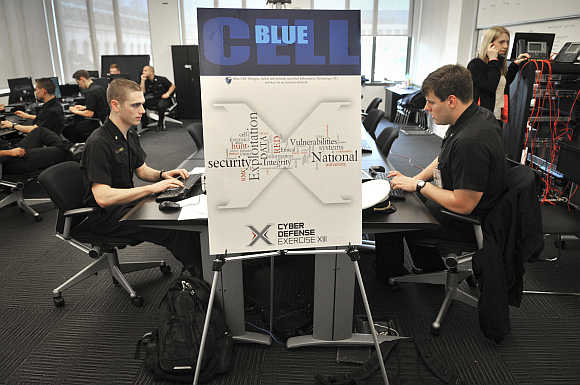 Competitors participate in the National Security Agency cyber competition at the US Naval Academy in Annapolis, Maryland.