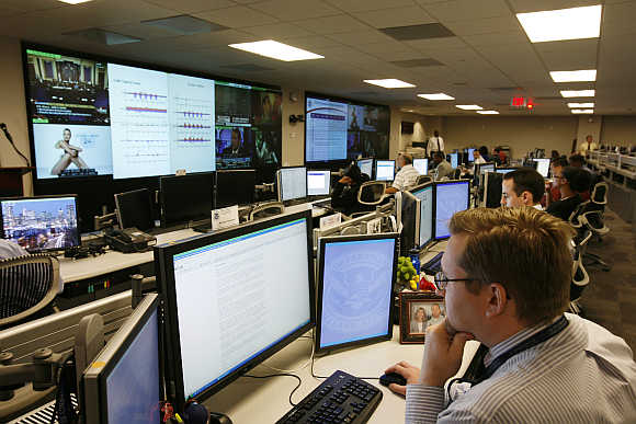 US Department of Homeland Security analysts work at the National Cybersecurity & Communications Integration Center located just outside Washington in Arlington, Virginia.