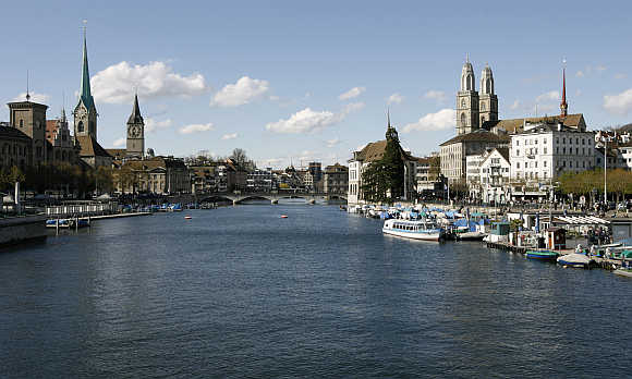 A view shows the city of Zurich and the Limmat River. On right is the Grossmuenster church.
