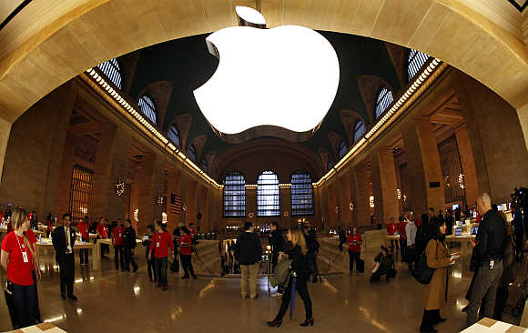 Apple's logo hangs inside the Apple Store in New York City's Grand Central Station.