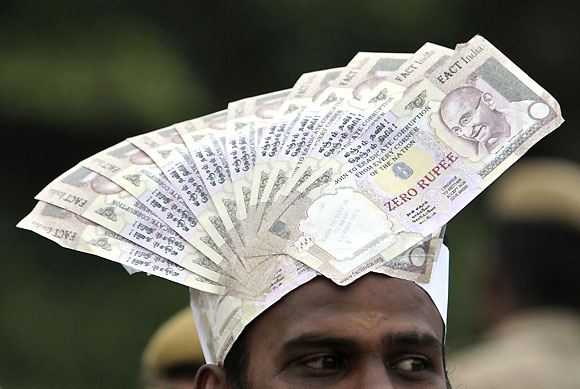 Rupee slide: Mixed bag for India Inc