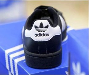 A shoe of the Adidas fashion line is pictured in a Munich shoe shop.
