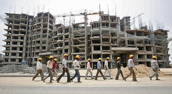 Workers in front of a construction site of a commercial complex on the outskirts of Ahmedabad.