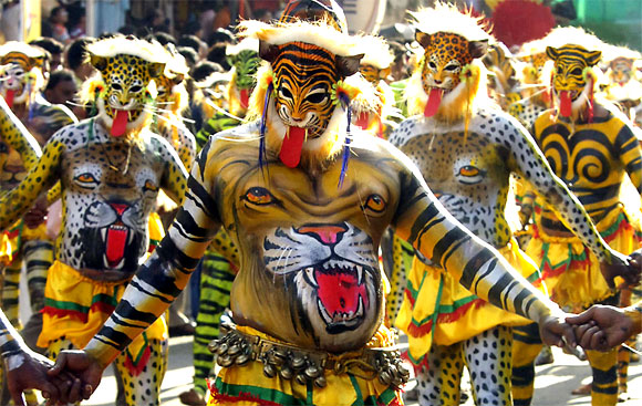 Performers dressed as tigers take part in Pulikali, or tiger dance, during festivities in Trichur city in Kerala.