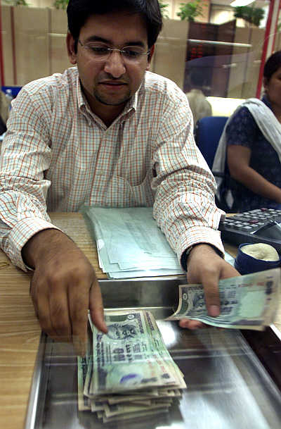 A forex dealer counts rupee notes in Mumbai.