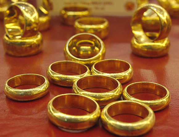 Gold products on sale are displayed at a shop in Hanoi, Vietnam.