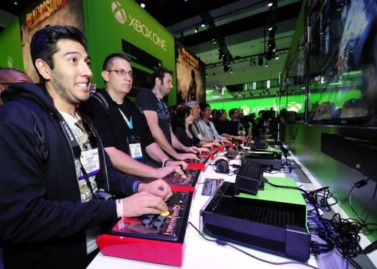 Gamers try out the Xbox One with a third party controller during E3 in Los Angeles, California.