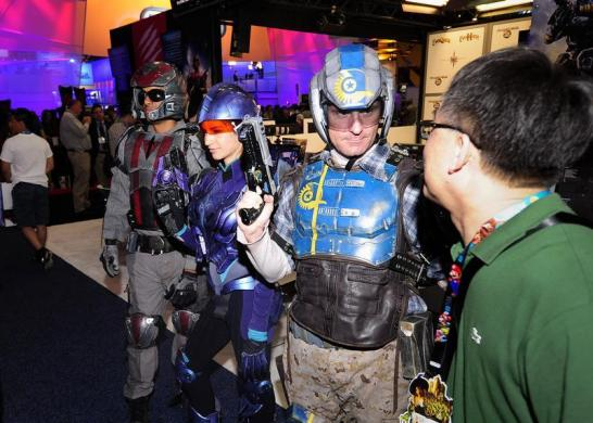A gamer meets Ever Quest 2 characters during E3 in Los Angeles, California.