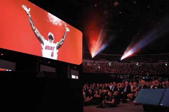 The audience watches Miami Heat star LeBron James in a game demonstration at the Sony news conference show on the eve of the opening of the Electronic Entertainment Expo, in Los Angeles, California.